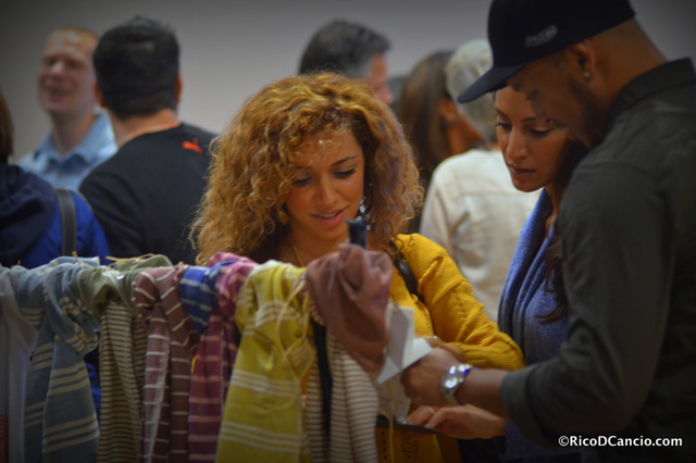 The silent auction attracting interest with hand-woven Ethiopian scarves.